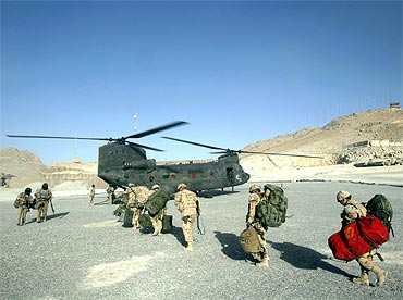 Soldiers board a CH-47 Chinook helicopter in Panjwai district in Kandahar province