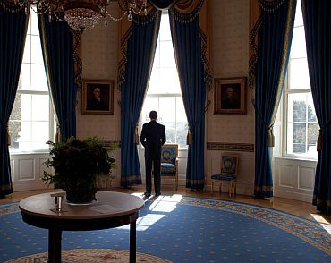 President Obama waits in the Blue Room before facing the press at a news conference