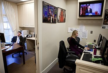 Deputy Press Secretary Josh Earnest and Press Assistant Caroline Hughes work in the Lower Press Office