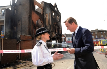 Prime Minister David Cameron talks to Acting Borough Commander Superintendent Jo Oakley during a visit to Croydon