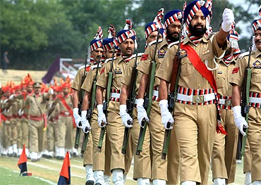 Police personnel march during India's Independence Day celebrations in Srinagar