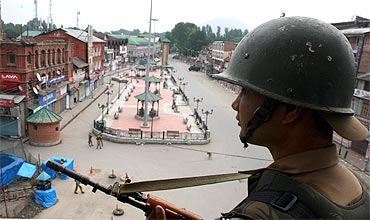 Paramilitary sharpshooters on rooftops keep a strict vigil in Srinagar