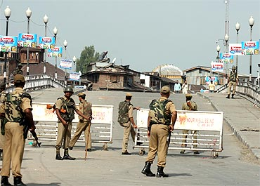 Paramilitary forcers guard the streets of Srinagar
