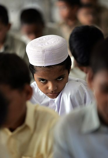 A madrassa student reads the Quran