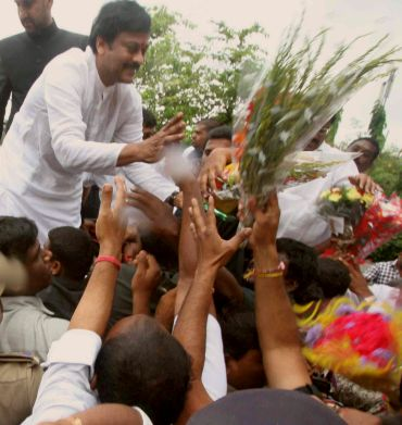 Well-wishers of K Chiranjeevi congratulate him after he was formally inducted into the Andhra Pradesh Congress
