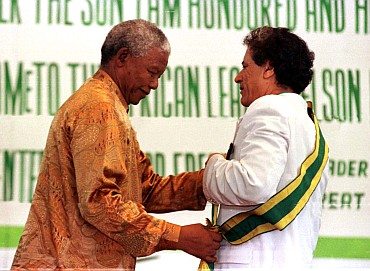 Gaddafi with former South Africa President Nelson Mandela