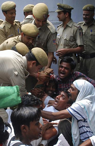 Police remove supporters of veteran Indian social activist Anna Hazare, who were protesting outside the residence of Finance Minister Pranab Mukherjee in New Delhi