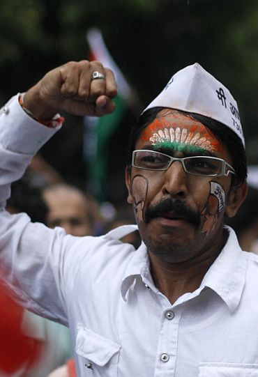 A supporter of veteran Anna Hazare shouts slogans at a rally against corruption in Mumbai