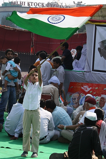 A child waves the tricolour as celebreations break out at Ramlila Maidan on Sunday