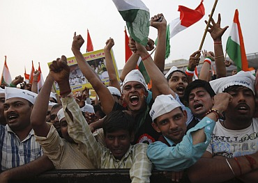 Supporters of veteran Indian social activist Anna Hazare shout slogans at the Ramlila ground