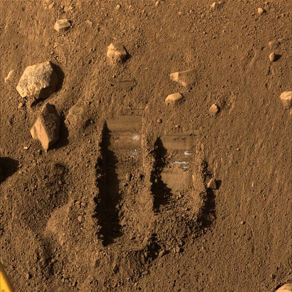 NASA's Phoenix Mars Lander's Surface Stereo Imager shows two trenches dug by Phoenix's Robotic Arm