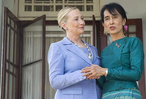 US Secretary of State Hillary Clinton and Myanmar's pro-democracy opposition leader Aung San Suu Kyi speak to the media at Suu Kyi's residence in Yangon on December 2. Clinton held a second meeting with Suu Kyi as she wrapped up a landmark visit to Myanmar which saw the new civilian government pledge to forge ahead with political reforms and re-engage with the world community