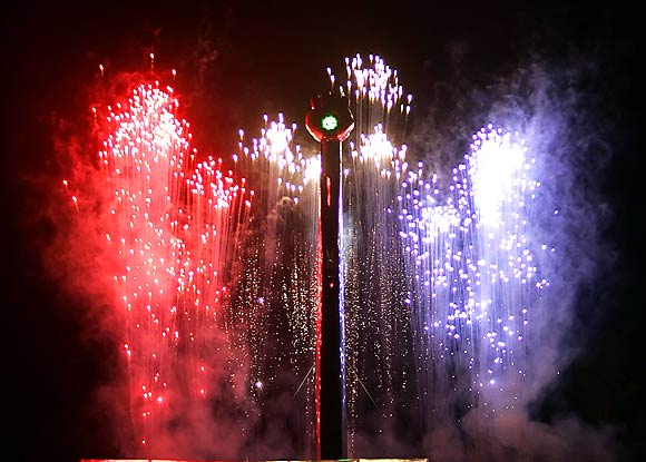 Red, white and blue fireworks are exploded around the Hunter S. Thompson memorial tower in Woody Creek, Colorado August 20, 2005. Writer and journalist Hunter S. Thompson's ashes was fired into the sky amid fireworks