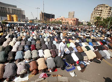 Protesters pray in Tahrir square during an anti-Mubarak protest in Cairo on Tuesday