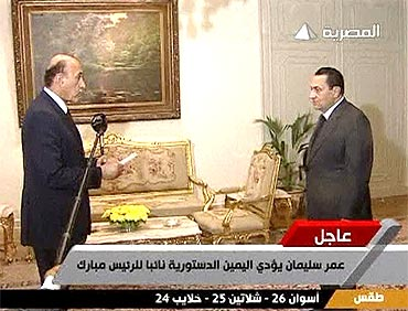 Egyptian President Hosni Mubarak swears in Omar Suleiman as vice president in Cairo, in this still image taken from video dated January 29, 2011