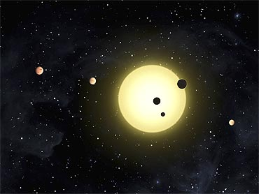 In this artist's conception released by NASA Kepler-11 is a sun-like star around which six planets orbit