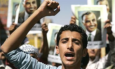 A protester shouts slogans during a demonstration in Sanaa, Yemen on Friday in support of Egypt protests