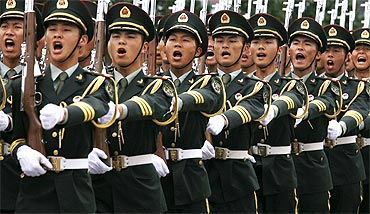 Chinese soldiers march during a ceremony