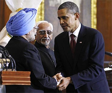 US President Barack Obama is thanked by Prime Minister Manmohan Singh at Parliament House in New Delhi