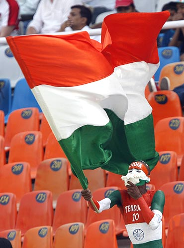 An Indian cricket fan waves the tricolour during a Test match between Australia and India in Mohali.