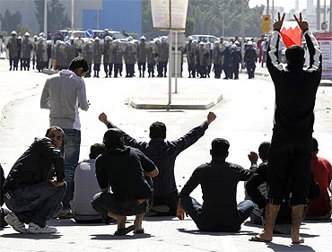 Bahrain youths demonstrate in front of the police in Manama