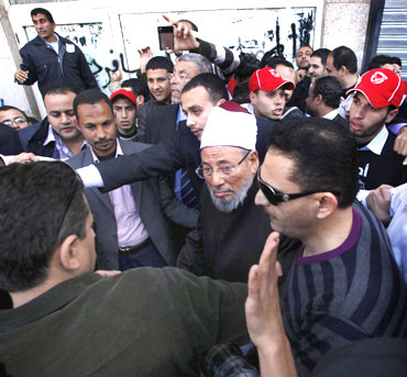Egyptian cleric Sheikh Yousef al-Qaradawi arrives to lead the Friday prayers in Tahrir Square