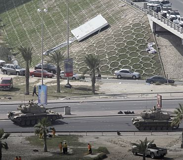 Military tanks are seen on the road to the Pearl Roundabout in Manama