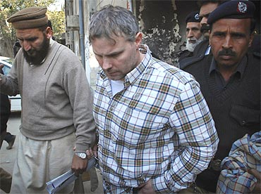 Raymond Davis is escorted out of a Lahore court