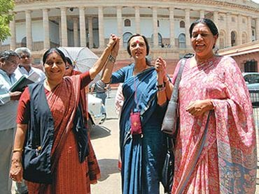 Women Opposition leaders celebrate the passage of the Bill in Rajya Sabha