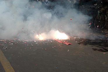 People burst firecrackers to celebrate HC's decision to uphold Kasab's death sentence in Mumbai on Monday