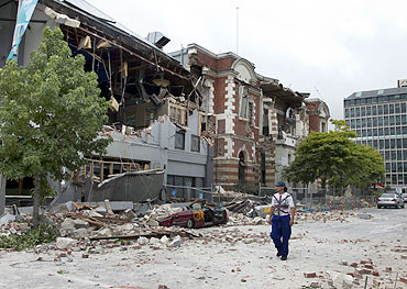 A man walks amongst rubble in central Christchurch