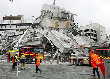 Rescue crews look for staff in a damaged building in central Christchurch