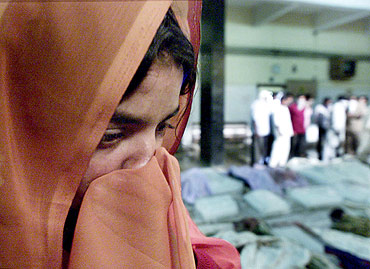 A file photo of a woman searching for her family members at a morgue in Ahmedabad, a day after the Godhra carnage