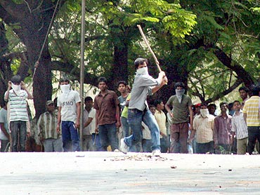 Pro-Telangana protestors clash with security personnel during the shutdown on Tuesday