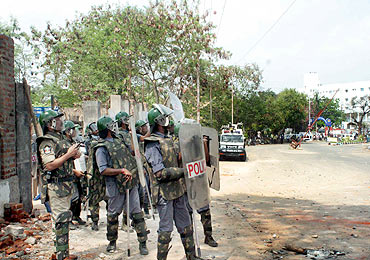 Police personnel used tear gas shells to disperse the agitating protestors