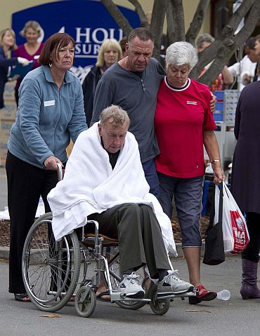 An injured resident arrives at the car park of a 24-hour surgery on Bealey Avenue in Christchurch