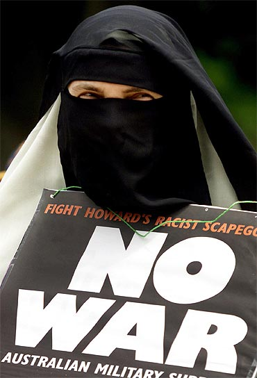 A Muslim woman from Sydney participates in a peace rally condemning racism