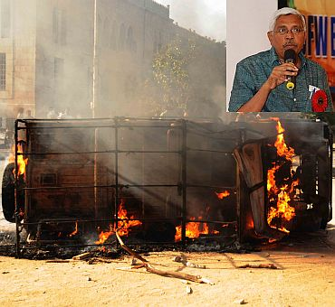 A police vehicle set afire by protestors. (Inset) Professor M Kodandaram