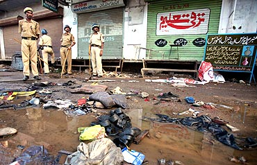 Police officials stand guard at a blast site outside a mosque in Malegaon