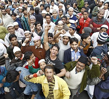 Demonstrators shout slogans during a demonstration in protest against efforts by local authorities to demolish what police described as an illegally built mosque in New Delhi