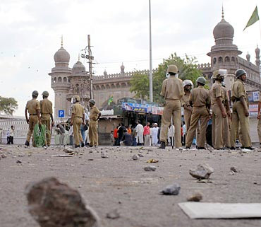 Policemen stand guard at the Mecca Masjid, Hyderabad