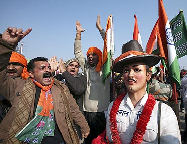 BJP supporters shout slogans next to a model of freedom fighter Bhagat Singh in Madhopur, Punjab