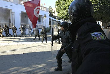 Tunisian riot police clash with protesters near government offices in the Casbah, the old city of Tunis