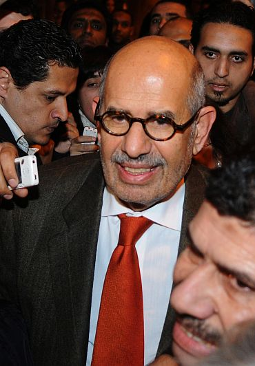 Egyptian reformed campaigner Mohamed ElBaradei talks to journalists outside Cairo's airport