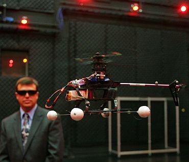 Dr Gregory Parker, Micro Air Vehicle team leader, observes a computer controlled drone