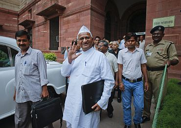 Anna Hazare and Arvind Kejriwal, members of the joint Lokpal drafting committee, step out after a meeting in New Delhi