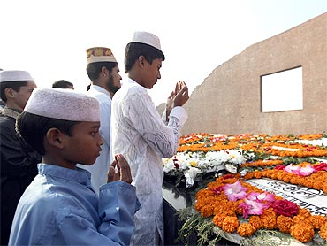 Visitors pray at the Martyred Intellectuals Memorial at Rayerbazar, Dhaka