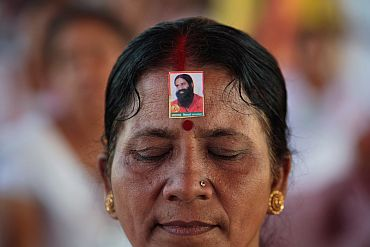 A supporter wears an image of Baba Ramdev at Ramlila grounds in New Delhi