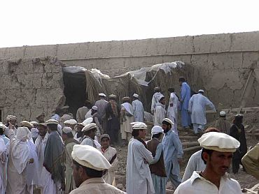 Tribesmen gather after a missile attack near the town of Wana in South Waziristan