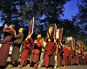 Buddhist monks attend a candlelight vigil in support of Karmapa Lama in New Delhi on February 11, 2011